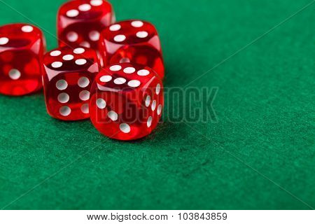 Red dice on a green felt
