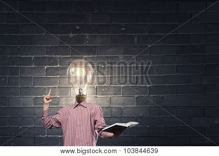 Unrecognizable businessman with light bulb instead of head