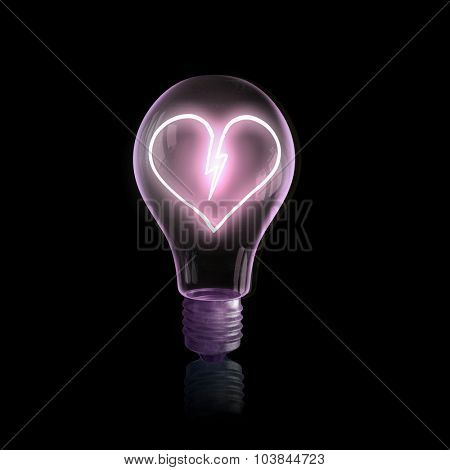 Glass light bulb with heart sign on black bakground