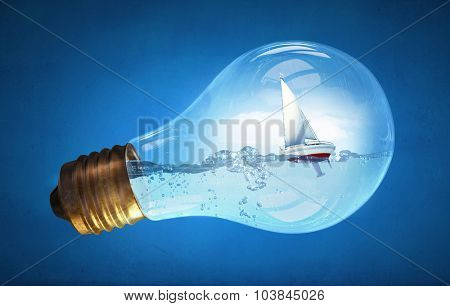 Concept of ecology with light bulb filled with water and boat floating inside