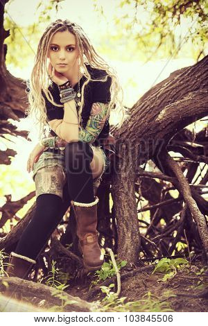 Attractive boho style girl in the wild wood. Boho, hippie fashion shot.