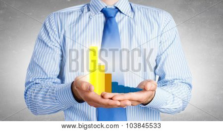 Close up of businessman holding increasing graph in palm