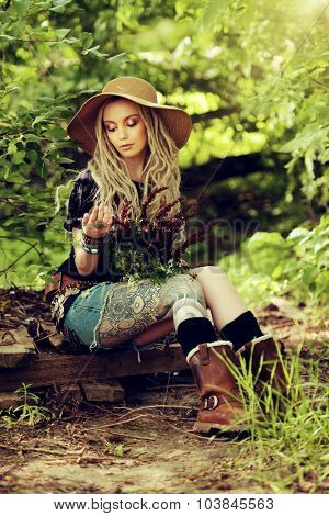 Beautiful boho style girl in the wild wood. Boho, hippie fashion shot.