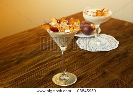 Yogurt Dessert With Plums And Wheat Flakes. Healthy Dessert With Muesli
