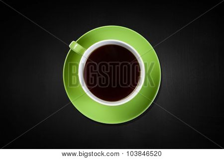 Top view of cup of coffee on dark background