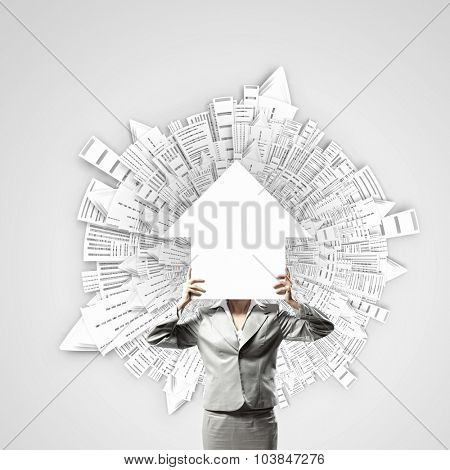 Unrecognizable businesswoman holding paper covering her face