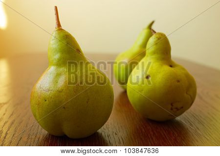 Ripe Pears On Rustic Table