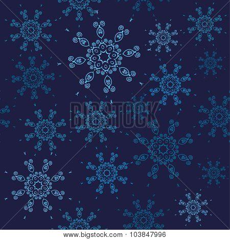 Seamless snowflakes pattern. Christmas design with blue snowflakes on dark navy background