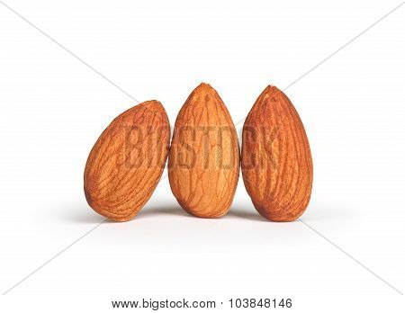 Three Almonds Isolated On White Background.