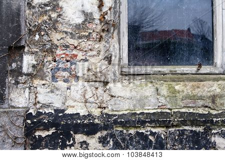 Brick Wall With Layers Of Weathered Stucco