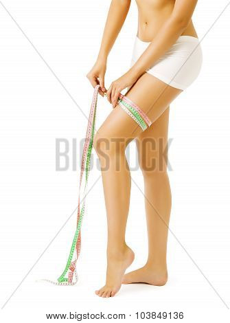 Woman Measure Leg By Measuring Tape, Slimming Girl Over White Background, Weight Loss
