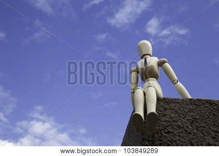 Businessman Puppet On The Edge