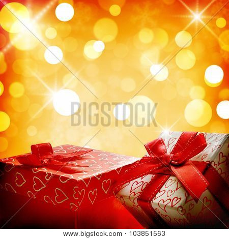 Two Decorative Gift Boxes Golden Bokeh Close Up