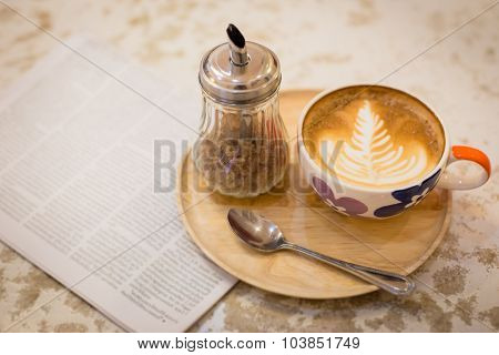Hot Latte Art Coffee With Newspaper On Wooden Table, Vintage And Retro Style