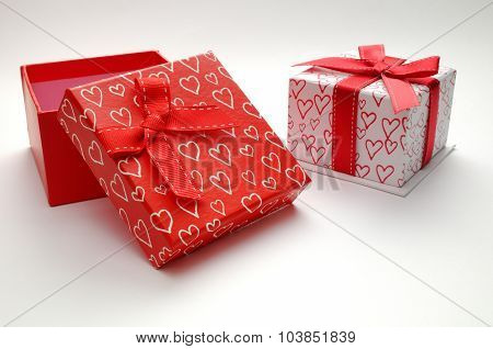 Two Decorative Gift Boxes With Hearts Printed Isolated Open Red