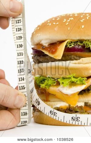Isolated Huge Burger On Scales