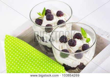 Soft Cheese Dessert With Whipped Cream And Fresh Blackberries
