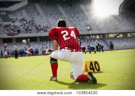 American football player on its knee