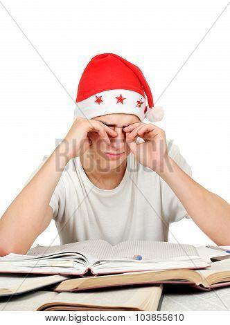 Tired Student In Santa Hat