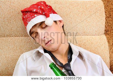 Young Man Sleep In Santa Hat