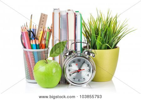 School and office supplies. Notepads, colorful pencils, flower, alarm clock and apple. Isolated on white background