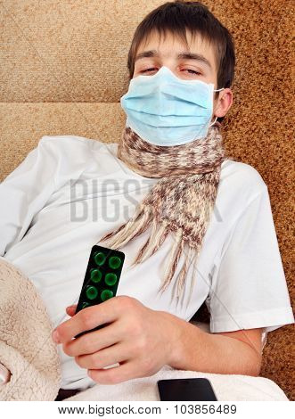 Sick Young Man In Flu Mask
