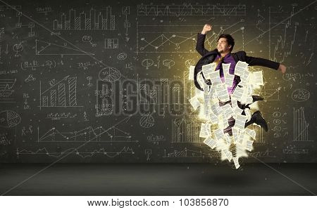 Handsome businessman jumping with paper document cloud around him