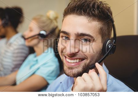 Portrait of smiling executive working in call center