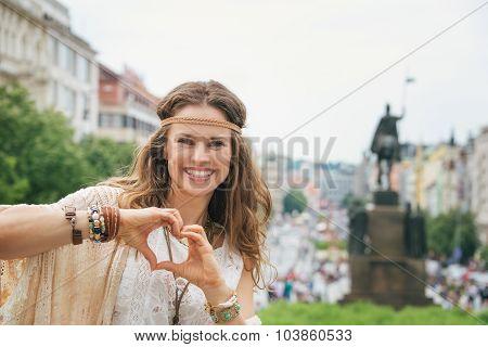 Bohemian Woman Tourist In Prague Showing Heart Shaped Hands