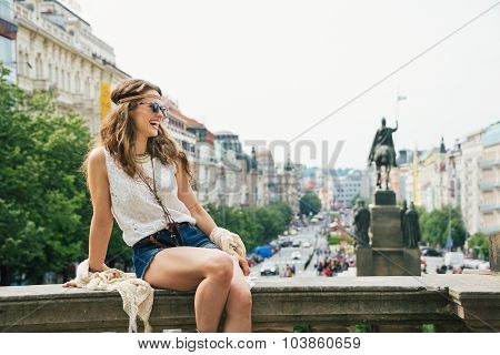 Happy Woman In Boho Chic Clothes Relaxing On Parapet, Prague