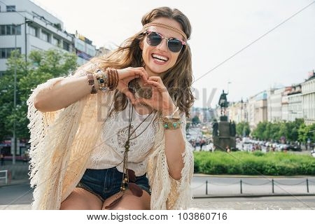 Longhaired Hippy-looking Young Lady Showing Heart Shaped Hands