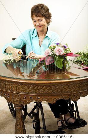 Disabled Florist Trims Babys Breath