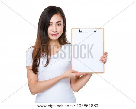 Young woman show with the blank page of clipboard