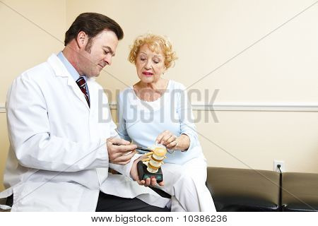 Chiropractor And Senior Woman
