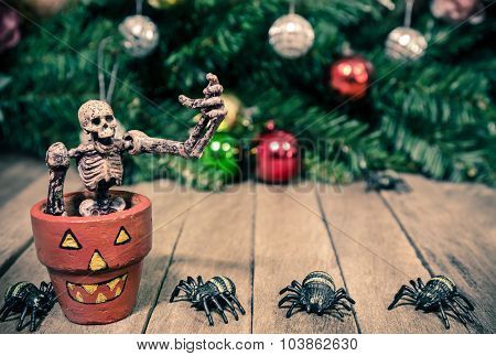 Funny Skeleton Sitting in Pot on Halloween Wooden Background Texture