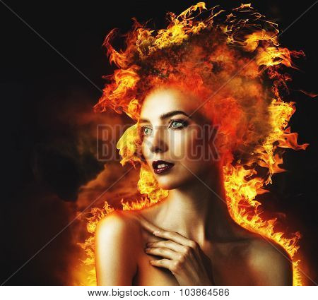 Firestarter. Abstract beauty portrait with burning flame as part of human