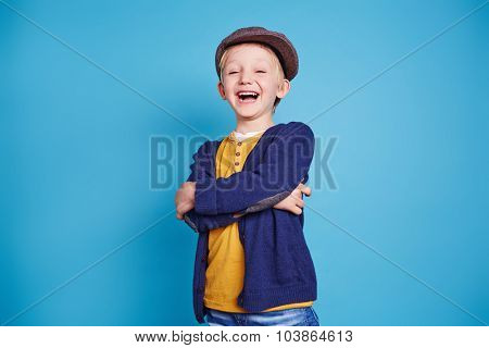 Laughing boy in casualwear in isolation