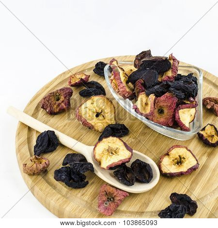 Dry fruits on wooden board.