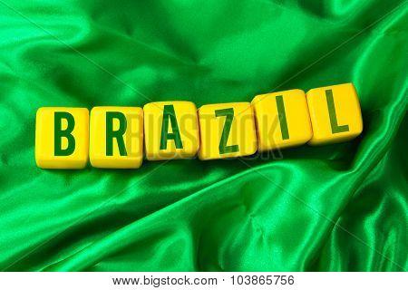 Brazil written on yellow cube on green background