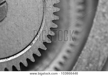 Black-and-white Metal Cogwheels In Clockwork. Macro