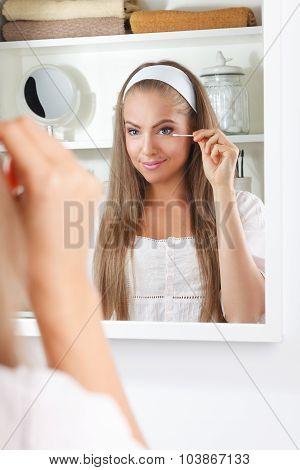 Pretty Woman Using A Cotton Swab