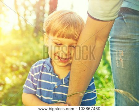 Smiling boy holding father's hand