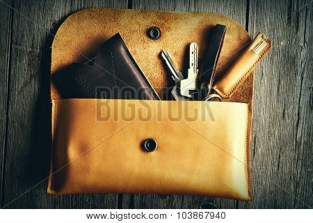 Handmade leather product over wooden background