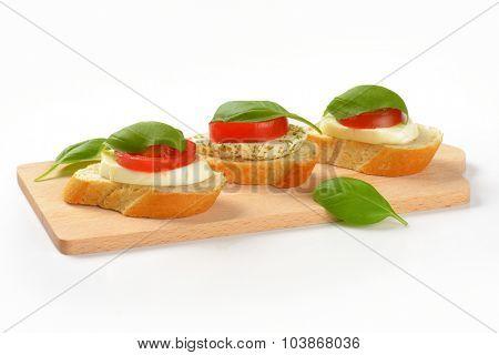 mozzarella sandwiches on wooden cutting board