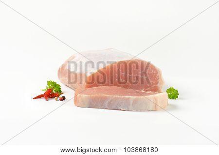 chopped raw pork tenderloin on white background