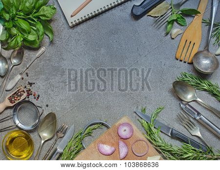 Antique Cutlery With Condiment, Herb And Olive Oil On Grey Stone Table