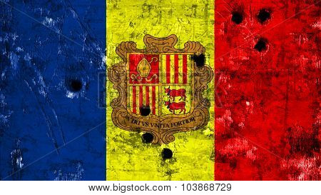 Flag of Andorra painted on metal texture with bullet holes.