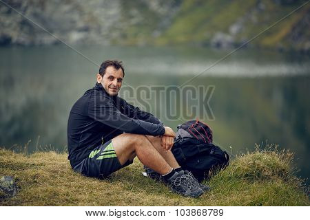 Hiker Near The Mountain Lake