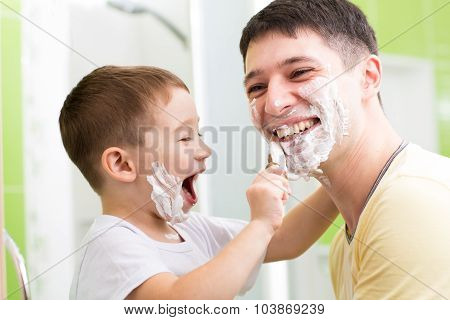 Father and his kid son playing in bathroom