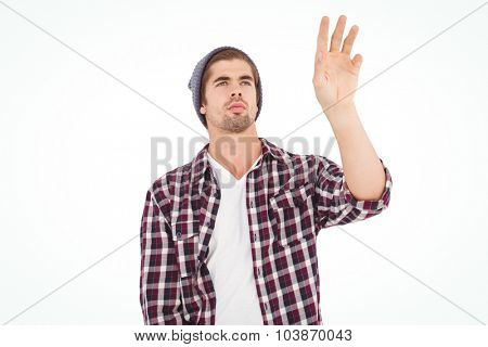 Man gesturing while standing against white background